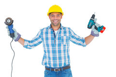 Manual worker holding power tools Royalty Free Stock Image