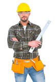 Manual worker holding spirit level with arms crossed. On white background stock image