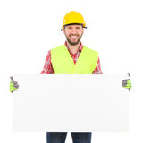 Manual worker holding white placard Royalty Free Stock Photography