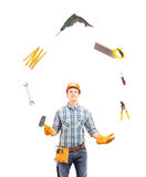 Manual worker juggling with tools Stock Image