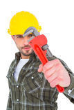 Manual worker looking through monkey wrench Stock Photography