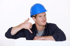 Manual worker making a phone shape royalty free stock photos