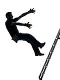 Manual worker man falling from ladder silhouette. One manual worker man falling from ladder in silhouette on white background royalty free stock photos