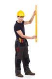 Manual worker measuring Royalty Free Stock Photos