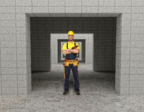 Manual worker in modern building stock photos