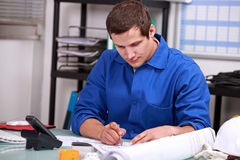 Manual worker in office Royalty Free Stock Photos