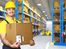 Manual worker with parcel. And warehouse parcel royalty free stock images