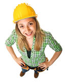 Manual worker portrait. Funny portrait of young woman at work Royalty Free Stock Photos