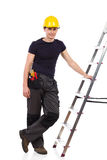Manual worker posing with a ladder. Royalty Free Stock Images