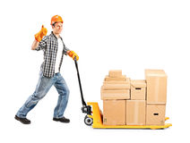 Manual worker pushing a fork pallet truck stacker royalty free stock photo