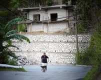Manual worker pushing a wheelbarrow, Jamaica Royalty Free Stock Image