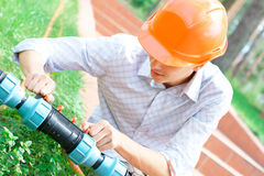 Manual worker repairing a pipe Royalty Free Stock Image