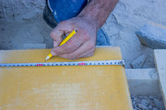 Manual worker with a ruler and pencil Royalty Free Stock Images
