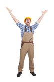 Manual worker screaming with hands raised Stock Photos