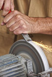 Manual worker sharp his tool. Manual worker detail, make his tool sharp on classic grindstone stock photo