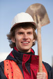 Manual worker with shovel Stock Image