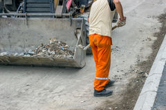 Manual worker with shovel  Royalty Free Stock Photos
