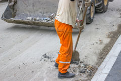Manual worker with shovel Royalty Free Stock Photo