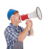 Manual worker speaking into megaphone Stock Photos