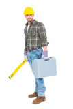 Manual worker with spirit level and toolbox Royalty Free Stock Images