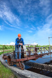 Manual worker standing on waste water treatment unit Royalty Free Stock Photos