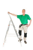 Manual worker with stepladder Royalty Free Stock Images