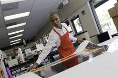 Manual worker taking large printouts Stock Photography