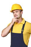 Manual worker thinking stock images