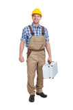 Manual Worker With Toolbox. Full length portrait of young manual worker with toolbox over white background Stock Photos