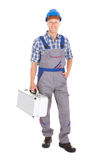 Manual Worker With Toolbox. Full length portrait of young manual worker with toolbox over white background Royalty Free Stock Image