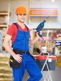 Manual worker with tools at warehouse. Portrait of smiling manual worker with tools at warehouse Royalty Free Stock Photography