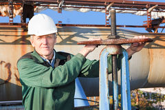 Manual worker turning big valve stock photo