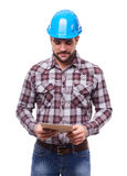 Manual worker using a digital tablet Stock Image