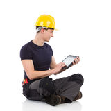 Manual worker using a digital tablet Royalty Free Stock Photography