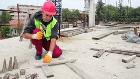 Manual Worker Using Hammer at Construction Site