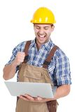 Manual worker using laptop Royalty Free Stock Photos