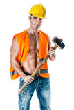 Manual worker. A very muscular and handsome manual worker with a sludgehammer and a yellow helmet isolated over white Royalty Free Stock Photography