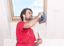 Manual worker with wall plastering tools inside a house Royalty Free Stock Photos