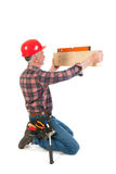 Manual worker with water rule Royalty Free Stock Photo
