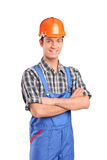 Manual worker wearing blue overall and helmet. Isolated on white background Royalty Free Stock Images