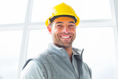 Manual worker wearing hardhat in building Stock Photo