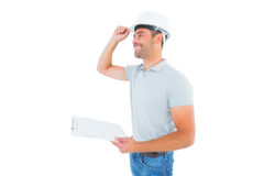 Manual worker wearing hardhat while holding clipboard Stock Photography