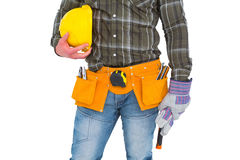 Manual worker wearing tool belt while holding gloves and helmet. On white background Stock Images