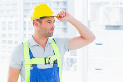 Manual worker wearing yellow hard hat Stock Photos