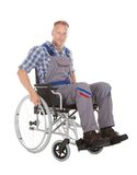 Manual Worker In Wheelchair. Full length of manual worker in wheelchair over white background stock images