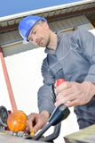 Manual worker working on machinery in metal industry stock photo