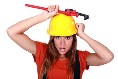 Manual worker with a wrench. Royalty Free Stock Photos