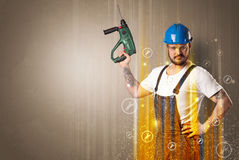 Manual worker with wrench symbol. Stock Photos