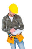 Manual worker writing on clipboard. Over white background Royalty Free Stock Images