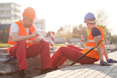 Manual workers having break. Image of tired manual workers having break stock image